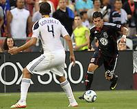 Santino Quaranta #25 of D.C. United moves towards Omar Gonzalez #4 of the Los Angeles Galaxy during an MLS match at RFK Stadium on July 18 2010, in Washington D.C.Galaxy won 2-1.