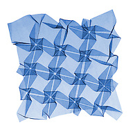 This is an x-ray of a mathematical origami.  Mathematical origami is a new and exciting field of mathematics.  This surface is made from a single sheet of paper with numerous folds and no cuts..