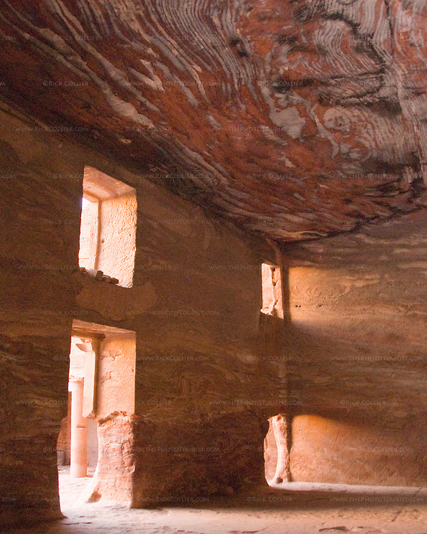 """Inside the """"Urn Tomb,"""" Petra, Jordan.  The ceiling and walls of this hand-carved space reveal the fantastic grain of the natural sandstone rock from which it was carved.  © Rick Collier"""