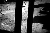 Wroclaw 19.05.2006 Poland<br /> The worst and the most dangerous district in Wroclaw ( Poland ) , called by people &quot;The Bermuda Triangle&quot;. There are walls bearing an inscription &quot;Who will enter here, will not exit alive&quot; Many families there are pathological and live in extreme poverty. Children have no place for any games so they loaf around on this wasted district and disseminate a juvenile delinquency. Many of them become sexually active though they are only 10-12 years old<br /> (Photo by Adam Lach / Napo Images)<br /> <br /> Najbardziej nabezpieczna dzielnica we Wroclawiu zwana przez ludzi Trojkatem Bermudzkim. Sa tam sciany opatrzone napisem &quot; Kto tu wejdzie, nigdy nie wyjdzie stad zywy&quot; Mieszka tam wiele rodzin patologicznych i zyja w wielkiej nedzy. Dzieci wlocza sie po ulicach nie majac miejsc na zabawe i szerza przestepczosc wsrod nieletnich. Wiele z dzieci uprawia seks choc maja zaledwie 10-12 lat<br /> (Fot Adam Lach / Napo Images)