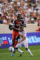 Tony Tchani (32) of Toronto FC and Dane Richards (19) of the New York Red Bulls battle for the ball. The New York Red Bulls defeated Toronto FC 5-0 during a Major League Soccer (MLS) match at Red Bull Arena in Harrison, NJ, on July 06, 2011.