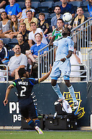 Kei Kamara (23) of Sporting Kansas City heads the ball as Carlos Valdes (2) of the Philadelphia Union watches. Sporting Kansas City defeated the Philadelphia Union 2-0 during the semifinals of the 2012 Lamar Hunt US Open Cup at PPL Park in Chester, PA, on July 11, 2012.
