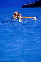 Great action shot of outrigger canoe paddlers making their way back to shore. Set against a vivid blue ocean.