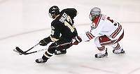 Ohio State's Brandon Martell (5) chases Western Michigan's Chase Balisy (13) during a NCAA hockey game at Value City Arena, Friday, Feb. 15, 2013 in Columbus, Ohio. (Photo for the Dispatch by Mike Munden)