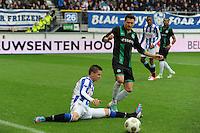 VOETBAL: HEERENVEEN: Abe Lenstra Stadion, 21-10-2012, SC Heerenveen - FC Groningen, Einduitslag 3-0, Jukka Raitala (#20 | SCH), Andraz Kirm (#17 | Groningen), ©foto Martin de Jong