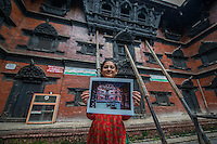 Nepal, Kathmandu, earthquake damage at Kathmandu Durbar Square. Photos of how the temples looked previously. Kumari House.
