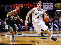 INDIANAPOLIS, IN - FEBRUARY 13: Erik Fromm #4 of the Butler Bulldogs dribbles the ball around Pierria Henry #15 of the Charlotte 49ers at Hinkle Fieldhouse on February 13, 2013 in Indianapolis, Indiana. Charlotte defeated Butler 71-67. (Photo by Michael Hickey/Getty Images) *** Local Caption *** Erik Fromm; Pierria Henry