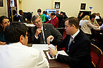 Congressman-elect Jim Bridenstine, from Oklahoma's First District, right, makes decisions about his future office, with his chief of staff Joe Kaufman, center, in the Rayburn House Office Building in Washington, DC on Nov. 30, 2012.
