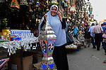 An Egyptian woman chooses traditional lanterns used for the holy month of Ramadan at a market in Cairo, Egypt, July 01, 2014. Muslim believers abstain from eating, drinking, smoking and having sex from dawn until sunset. Ramadan is sacred to Muslims because it is during that month that tradition says the Koran was revealed to the Prophet Mohammed. Photo by Mohammed Bendari