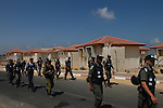 Israeli soldiers arrive in the settlement of Atzmona, in the  Israeli settlement bloc of Gush Katif, Gaza Strip, in order to evacuate the settlers living there.