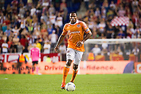 Jermaine Taylor (4) of the Houston Dynamo. The New York Red Bulls defeated the Houston Dynamo 2-0 during a Major League Soccer (MLS) match at Red Bull Arena in Harrison, NJ, on August 10, 2012.