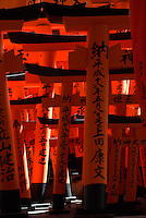 "Detail of small red torii gates at Fushimi Inari Shrine, Kyoto. The shrine is better known for its ""tunnel"" of vermilion torii gates."