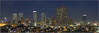 This image  is an evening skyline view of Fort Worth, Texas with architecture that includes buildings such as the Tarrant County Courthouse, the Wells Fargo Tower, the D R Horton Tower, the Fort Worth Tower, the Carter and Burgess Tower, the Burnett Plaza, the AT&T Building, and the Omni Fort Worth.