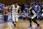04 November 2014: Duke's Quinn Cook (2) and Livingstone's Juwan Cole (right). The Duke University Blue Devils hosted the Livingstone College Blue Bears at Cameron Indoor Stadium in Durham, North Carolina in an NCAA Men's Basketball exhibition game. Duke won the game 115-58.