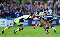 Jonathan Joseph of Bath Rugby takes on the Sale Sharks defence. Aviva Premiership match, between Bath Rugby and Sale Sharks on April 23, 2016 at the Recreation Ground in Bath, England. Photo by: Patrick Khachfe / Onside Images