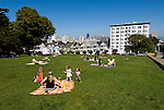 California: San Francisco. People relaxing in Alamo Square with view of Victorians and modern downtown. Photo copyright Lee Foster. Photo #: san-francisco-alamo-square-20-casanf79136