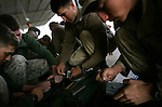 A few days before they begin the journey back to the United States after eight months in Najaf, Iraq, Marines with Charlie Co. 1st Battalion 4th Marines turn in their ammunition before the trip to Kuwait on January 31, 2005.