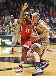 "Mississippi's Marshall Henderson (22) drives against Georgia's Vincent Williams (11) at the C.M. ""Tad"" Smith Coliseum on Saturday, February 16, 2013. Mississippi won 84-74 in overtime. Henderson scored 25. (AP Photo/Oxford Eagle, Bruce Newman)"