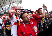 A group of New York fans cheers jeers the Philadelphia fans before the game at PPL Park in Chester, PA.  New York defeated Philadelphia, 3-0.