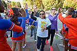 Participants are greeted by cheerleaders from a local high school as they finish the CROP Hunger Walk in Raleigh, North Carolina, on October 27, 2013.
