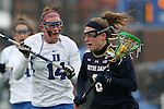01 March 2015: Notre Dame's Stephanie Toy (right) and Duke's Taylor Trimble (14). The Duke University Blue Devils hosted the University of Notre Dame Fighting Irish on the West Turf Field at the Duke Athletic Field Complex in Durham, North Carolina in a 2015 NCAA Division I Women's Lacrosse match. Duke won the game 17-3.