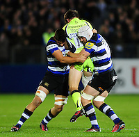 Charlie Ewels and Dave Attwood of Bath Rugby double-tackle AJ MacGinty of Sale Sharks. Aviva Premiership match, between Bath Rugby and Sale Sharks on October 7, 2016 at the Recreation Ground in Bath, England. Photo by: Patrick Khachfe / Onside Images