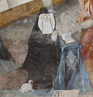 Detail of Petronille de Chemille (Petronilla of Chemille), first abbess of the double monastery of Fontevrault, Eleonore de Bourbon fresco, Chapter House, Fontevraud Abbey, Fontevraud-l'Abbaye, Loire Valley, Maine-et-Loire, France. The Chapter House was built in the 16th century and its walls were painted in 1563 with frescoes of scenes from Christ's Passion by the Anjou artist Thomas Pot. Here we see a detail from the Last Supper fresco added at a later date showing a portrait of Eleonore de Bourbon, 29th Abbess of Fontevraud (1575-1611) and aunt of King Henry IV of France, with her dog. The abbey itself was founded in 1100 by Robert of Arbrissel, who created the Order of Fontevraud. It was a double monastery for monks and nuns, run by an abbess. Picture by Manuel Cohen