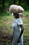 A woman walks along a path in the rural Haitian village of Mizak, where the United Methodist Committee on Relief (UMCOR) is helping farmers battle hunger by improving their agricultural practices.