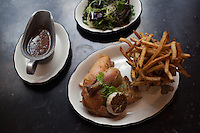 Poulet Frites; roasted chicken, french fries, jus provencal, mixed green salad and mustard vinaigrette at Rotisserie Georgette in New York, NY on July 08, 2014. The restaurant has an open kitchen framed in beautiful blue-an-white Portuguese tile.