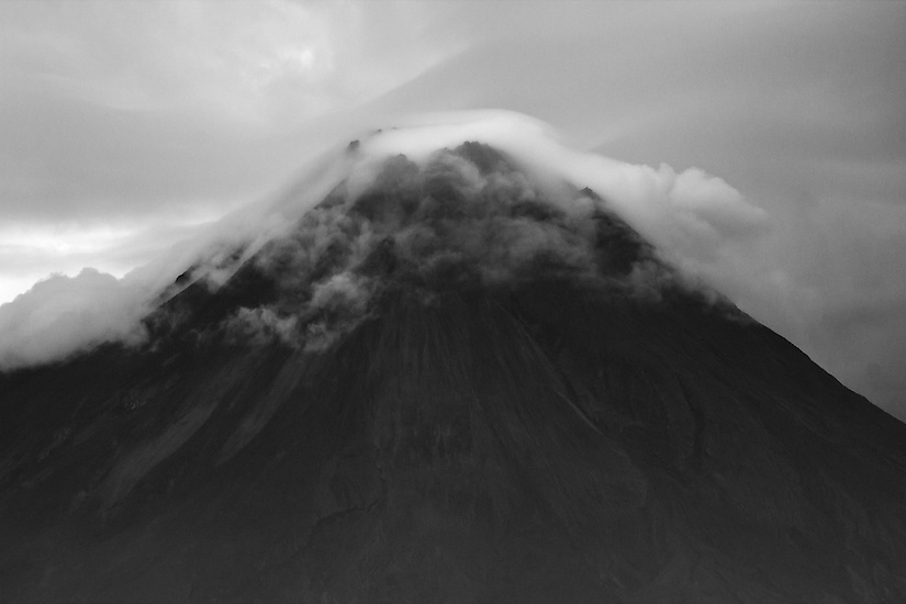 The top of Mount Merapi is shrouded in smoke and steam. Jogjakarta, Indonesia.