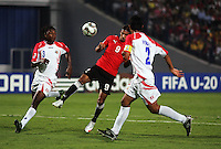 Egypt's Mohamed Talaat (9) kicks the ball away from Costa Rica's Roy Smith (3) and Jose Mena (2) during the FIFA Under 20 World Cup Round of 16 match between Egypt and Costa Rica at the Cairo International Stadium on October 06, 2009 in Cairo, Egypt.