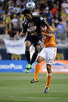 Sheanon Williams (25) of the Philadelphia Union and Brian Ching (25) of the Houston Dynamo go up for a header. The Philadelphia Union and the Houston Dynamo played to a 1-1 tie during a Major League Soccer (MLS) match at PPL Park in Chester, PA, on August 6, 2011.