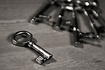 Antique keys on a table black and white