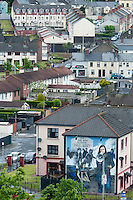 Londonderry, Derry, Northern Ireland, United Kingdom, May 2011. Murals on the houses of the catholic area Bogside depict the scenes from 'bloody Sunday' Londonderry, also known as Derry is the only remaining completely walled city in Ireland and one of the finest examples of Walled Cities in Europe. For decades travellers stayed away from the sectarian violence, but since the end of 'The Troubles' more and more people start discoving the beauty of Belfast and the Antrim Coast Causeway. Photo by Frits Meyst/Adventure4ever.com