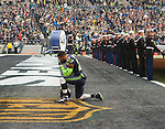 Seattle Seahawks free safety Earl Thomas takes a knee and prays before their game against the Cleveland Browns at CenturyLink Field in Seattle, Washington on December 20, 2015. The Seahawks clinched their fourth straight playoff berth in four seasons by beating the Browns 30-13.  ©2015. Jim Bryant Photo. All Rights Reserved.