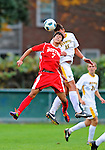 12 October 2011: Boston University Terriers' Midfielder Cameron Souri, a Freshman from Corona, CA, goes up against Salvatore Borea of the University of Vermont Catamounts at Centennial Field in Burlington, Vermont. The Catamounts were shut out 1-0 by the visiting Terriers. Mandatory Credit: Ed Wolfstein Photo