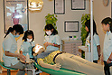 """KIDZANIA TOKYO, """"Edutainment City"""",.children practising dentistry."""