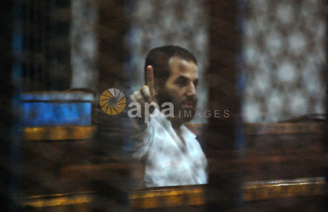 A member of Muslim Brotherhood sits inside a defendant's cage during the trial of former Egyptian President Mohamed Morsi in Cairo, Egypt on May 24, 2015. Cairo Criminal Court resumed Sunday the espionage trial of ousted president Mohamed Morsi and 10 co-defendants over charges of leaking to a foreign country, namely Qatar, top secret military reports pertaining to Egypt's Intelligence Authority and Armed Forces and related to the country's national security. Photo by Stringer