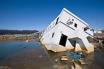 A block of apartments lies on its side near the waterfront in Rikuzentakata  Prefecture, Japan on  6 April 20011. The city was flattened by the March 11 earthquake and tsunamis that hit the area..Photographer: Robert Gilhooly