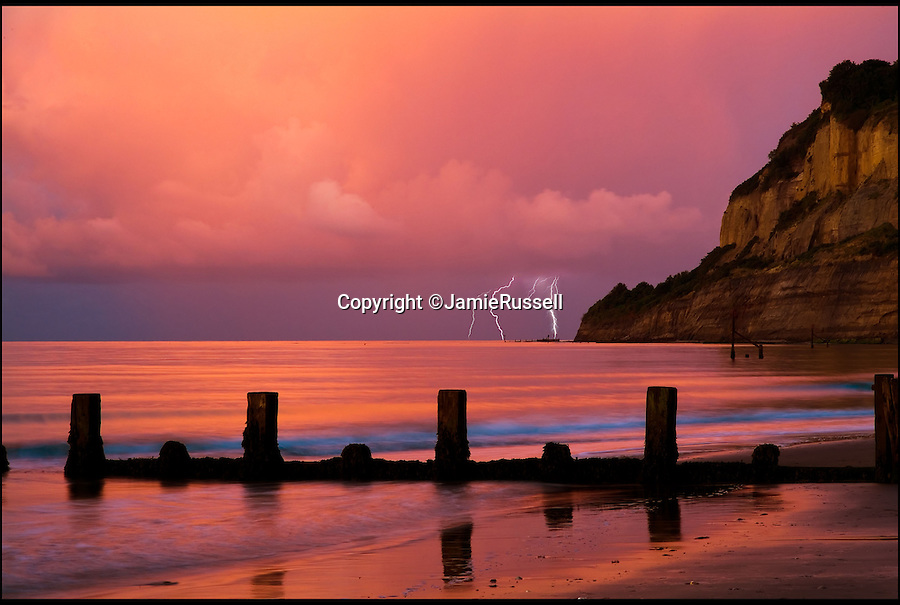 BNPS.co.uk (01202 55883&pound;)<br /> Pic: JamieRussell/BNPS<br /> <br /> ***Please Use Full Byline***<br /> <br /> Storm approaching Shanklin Chine.<br /> <br /> Stunning photographs have revealed a turbulent side to the normally genteel Isle of Wight.<br /> <br /> The seemingly benign south coast holiday destination has been catalogued over a stormy year by local photographer Jamie Russell, and his astonishing pictures reveal the dramatic changes in weather that roll across the UK in just 12 months.<br /> <br /> Lightning storms, ice, floods, gales and blizzards have all been captured by the intrepid photographer who frequently got up in the middle of the night to capture the climatic chaos.<br /> <br /> Looking at these pictures prospective holidaymakers could be forgiven for thinking twice about a gentle staycation on the south coast island.