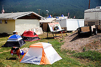 "Tents and trailers surround the ""Bullshit Pitch"" at the campground at the Testicle Festival at the Rock Creek Lodge in Clinton, MT.  The Rock Creek Lodge in Clinton, MT, has hosted the annual Testicle Festival since the early 1980s.  The four day festival and party revolves around the consumption of so-called Rocky Mountain Oysters, which are deep-fried bull testicles."
