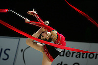 Stela Sultanova of Bulgaria turns pirouette with ribbon during All-Around competition at 2006 Thiais Grand Prix in Paris, France on March 25, 2006.  (Photo by Tom Theobald)