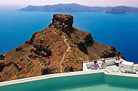 Hotel terrace overlooking the volcanic plug  of Imerovigli, Santorini, Greece.