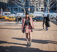 Fashionistas arrive and pose in their finery outside of the Fall 2014 Fashion Week shows in Lincoln Center in New York, seen on opening day, Thursday, February 6, 2014. This year some designers are abandoning the tents at Lincoln Center to hold their shows at far flung venues, including Brooklyn.  (© Richard B. Levine)