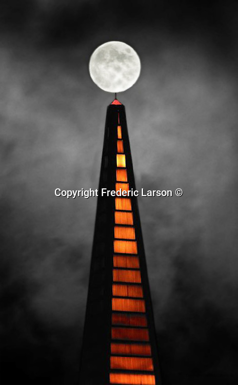 The rising moon over the TransAmerican Pyramid was aided by a thin layer of fog that drifted pass the full moon softening the hard light reflected by the sun. Taken on Taylor street on Russian Hill in San Francisco , California...