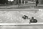 Bill Wild with Kirsten Wild in swimming pool. Swimming lesson. 1973. Montchanin, Delaware. File #73-147-3