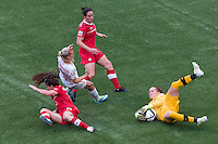 June 21, 2015: Erin McLEOD of Canada saves the ball during a round of 16 match between Canada and Switzerland at the FIFA Women's World Cup Canada 2015 at BC Place Stadium on 21 June 2015 in Vancouver, Canada. Canada won 1-0. Sydney Low/Asteriskimages.com