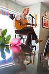A guitarist plays music at First Street Cafe on Valentine's Day.