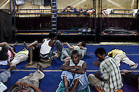 Men chat and sleep during the night shift (7pm -7am) at the Aashray Adhikar Abhiyan (AAA) Activity Center for homeless people on 4th October 2010, in Old Delhi, India. Picture: Suzanne Lee for The Australian.