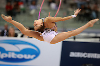 Evgenia Kanaeva of Russia split leaps with hoop on way to winning All-Around gold at 2008 European Championships at Torino, Italy on June 6, 2008.  Photo by Tom Theobald.
